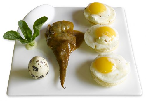 A plate of Momento's soft-boiled eggs and marinated artichoke